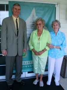image:Delaware State Forester Michael A. Valenti joins Patricia Huff Stenger, center, and Jeanne Sposato after completing the purchase of 339 acres of forestland from the Sposato and Huff families