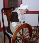 Eleanor Matthews, historic-site interpreter at the John Dickinson Plantation, demonstrating a spinning wheel.