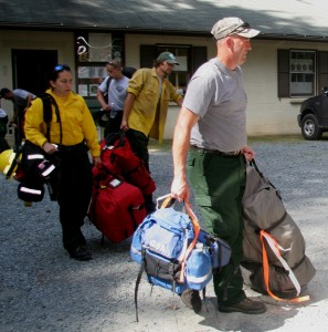"(from left) Amber DeCarlo of Felton, Chris Skrobot of Wilmington, Andy ""Doug"" Rawlings of Newark, and Jim Charney of Felton as they departed from Blackbird State Forest for the trip to battle a wildfire near North Pole, Alaska."