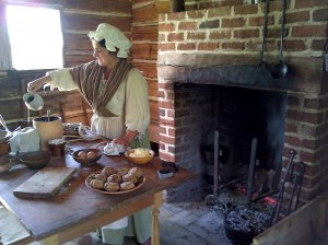 Martha Wagner, historic-site interpreter at the John Dickinson Plantation, conducting a hearth-cooking demonstration.
