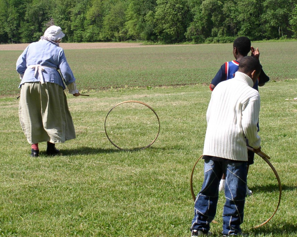 Children enjoying the Colonial game of rolling hoops at the John Dickinson Plantation.