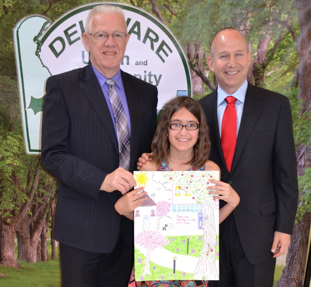 From left, Rep. Harvey R. Kenton joins the fifth-grader Isabella Garber of Christ the Teacher School in Newark, winner of the state's Arbor Day school poster contest, and Gov. Markell.