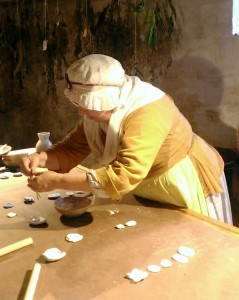 Historic-site interpreter Barbara Carrow demonstrating plaster casting at the John Dickinson Plantation.