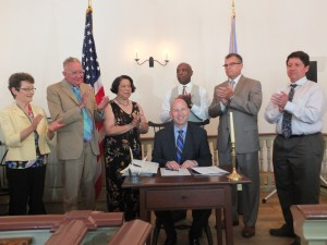 The Governor was joined by members of the General Assembly and others to sign eight bills to improve Delaware's election laws and aid the the Public Integrity Commission.