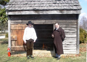 Historic-site interpreters outside the John Dickinson Plantation's smokehouse.