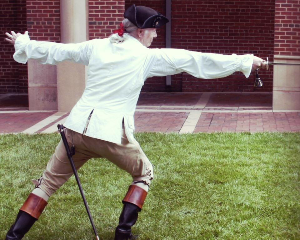 "A member of the Swordmasters demonstrating fencing technique. The living-history organization will be appearing at the ""Day in the Life of the John Dickinson Plantation"" program on Oct. 11, 2014."