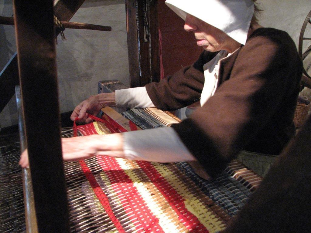 Eleanor Matthews, historic-site interpreter at the John Dickinson Plantation, conducting a weaving demonstration.