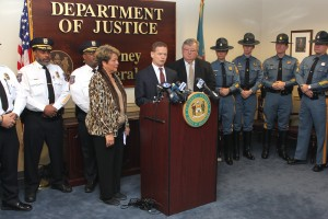 AG Denn at Press Conference