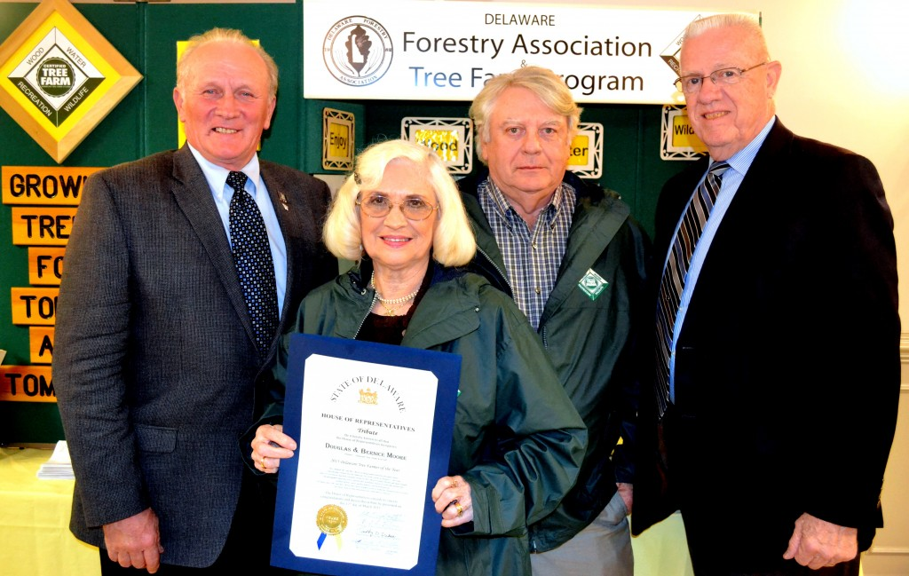 From left, Rep. David L. Wilson (R-35) joined Bernice and Douglas Moore and Rep. Harvey R. Kenton (R-36) to recognize the Moore's selection as Delaware Tree Farmers of the Year at the Delaware Forestry Association's annual banquet on March 12 at the Felton Fire Hall.