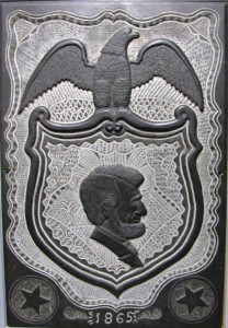 "Carved slate featuring a likeness of Abraham Lincoln. The object was on-board Lincoln's funeral train that left Washington, D.C. on April 21, 1865 bound for Springfield, Ill. It is part of the display ""Delaware Mourns Lincoln: A Demonstration of Love and Sorrow"" at The Old State House."