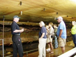 Visitors enjoying a tour of the DeBraak hull which can be seen in the left of the photo.