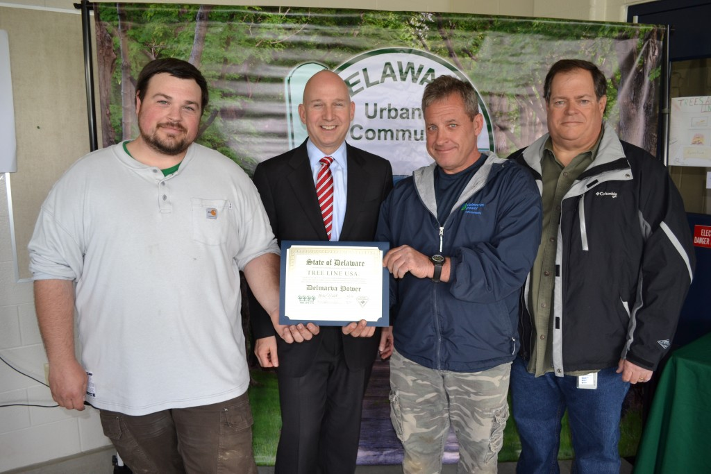 From left, Delmarva Power's Michael Krzyzanowski, Michael Casmay, and MAtt Simons receive the Tree Line USA Award from Governor Jack Markell. The utility donated more than 30 trees that were planted by Appoquinimink High School students and staff at the school's campus in Middletown.