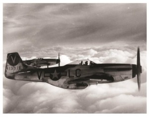 "Photograph of two P-51 Mustang fighter aircraft. The image is part of the display ""World War II Through the Lens of William D. Willis"" at Dover's Legislative Hall."