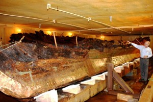 Interpreter pointing to the remaining section of the DeBraak's hull.