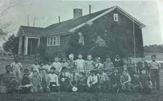 "Students posing in front of the Harmon School near Millsboro, Del. which served children from the Nanticoke Indian Tribe. Native American education will be explored in the program ""Lost and Found: Native American Identity in Delaware's Public Schools"" on Sept. 19, 2015."