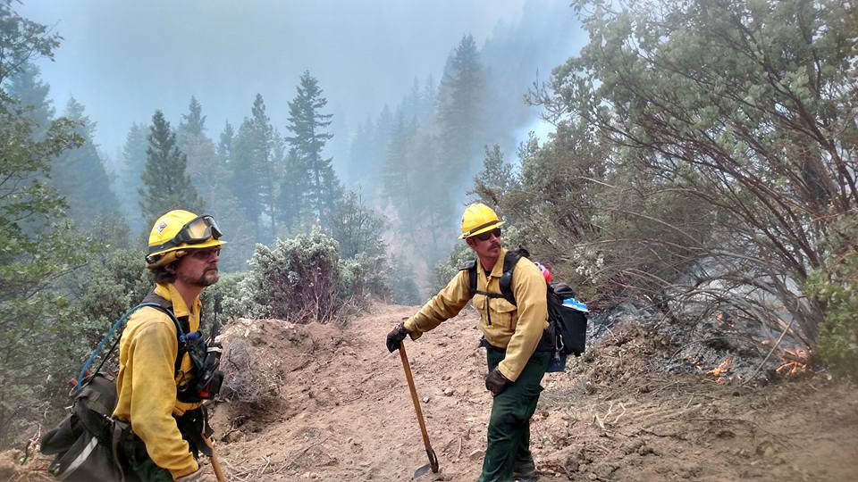 "From left, Andrew ""Doug"" Rawling of Newark is shown with Erich Burkentine of Milton as they work to contain the Fork Copmplex Fire in Northern California's Shasta-Trinity National Forest. Burkentine, the Delaware Forest Service's southern regional forester, is leading the 20-person team from Delaware. team"