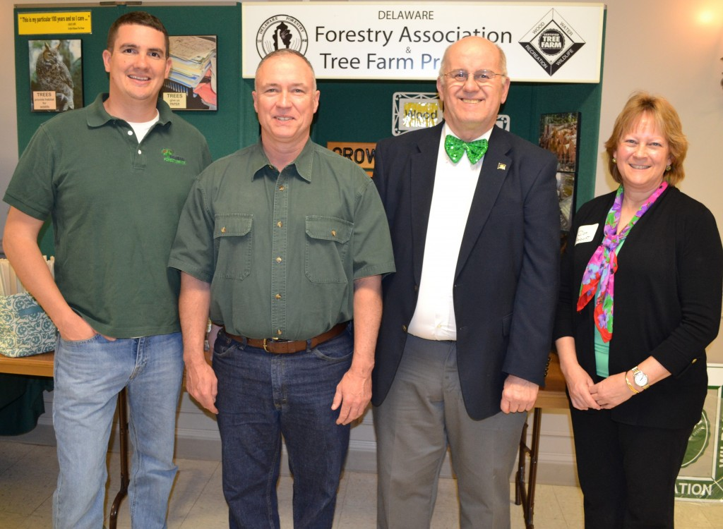 "From left, Kent County service forester Chris Miller, 2016 Tree Farmer of the Year Daniel J. Tartt, Jr. of Harrington, State Rep. William R. ""Bobby"" Outten (R-30), and Dot Abbott, Delaware State Tree Farm Director at the annual Delaware Forestry Association meeting."