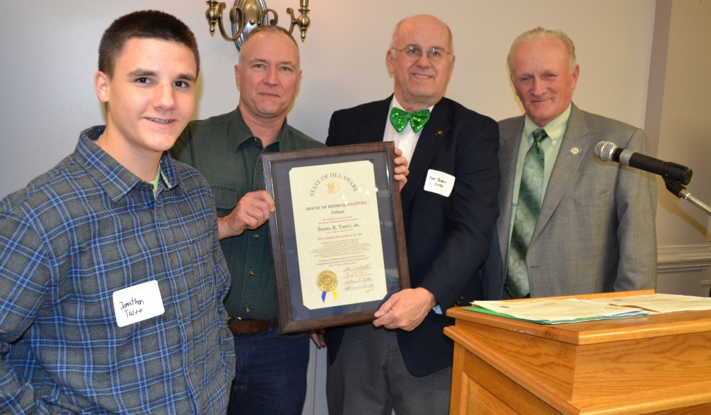 """From left, Jonathon Tartt and his father Daniel Tartt, Jr. are honored by Rep. William R. """"Bobby"""" Outten, and Rep. David L. Wilson with a proclamation recognizing Tartt as the 2016 Delaware Tree Farmer of the Year."""