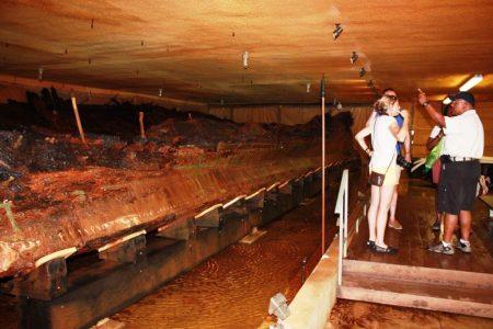 Photo of visitors enjoying a tour of the DeBraak hull.