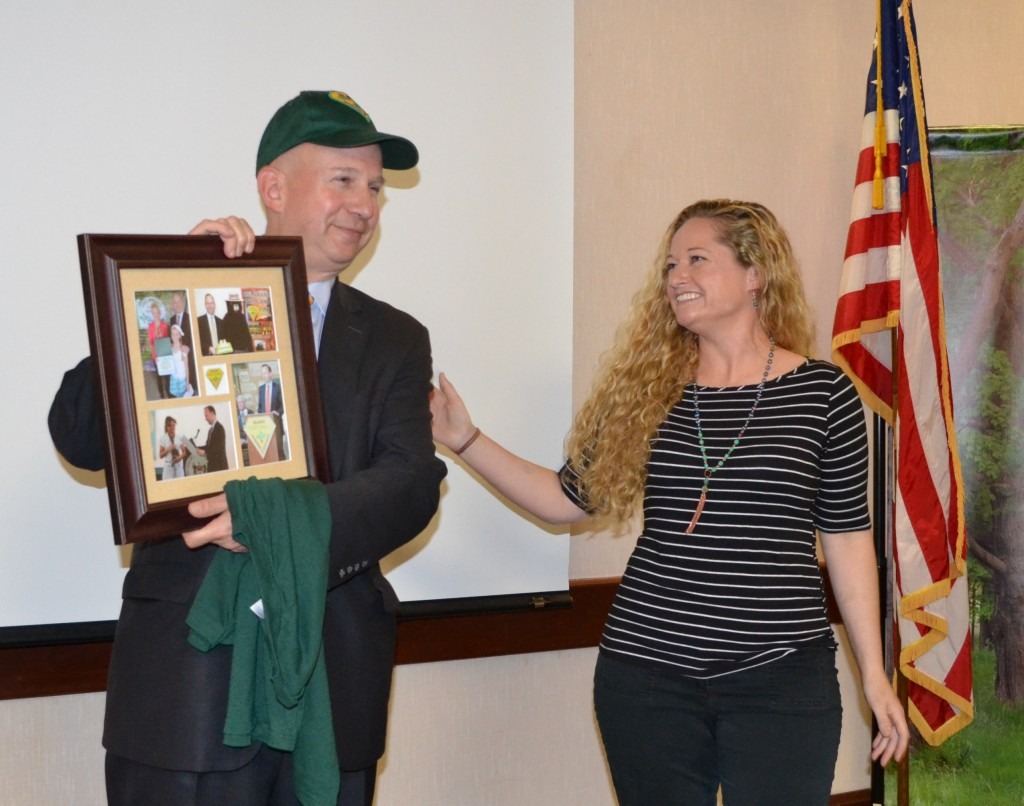 Governor Markell accepts a commemorative photo frame and Forest Service hat from Delaware Forest Service trainer-educator Ashley Peebles for his many years of supporting the statewide Arbor Day observance.