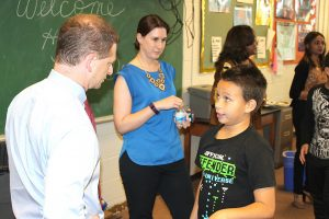 Attorney General Matt Denn speaks with a Bancroft Elementary School student.