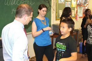 Attorney General Matt Denn speaks with a Bancroft Elementary School student.