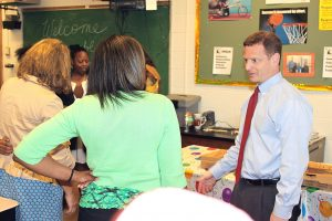 Attorney General Matt Denn speaks with some of the participants in the Big Brothers Big Sisters of Delaware mentoring program.