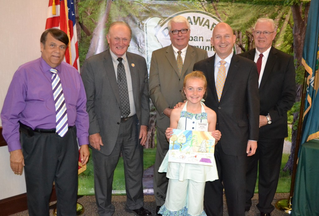 (from left) Dover Mayor Robin Christiansen, Rep. David L. Wilson, Secretary of Agriculture Ed Kee, Governor Jack Markell and Rep. Harvey Kenton congratulate state winner Rain Vasey, fifth-grader at Water Girl Farm Academy in Lincoln.