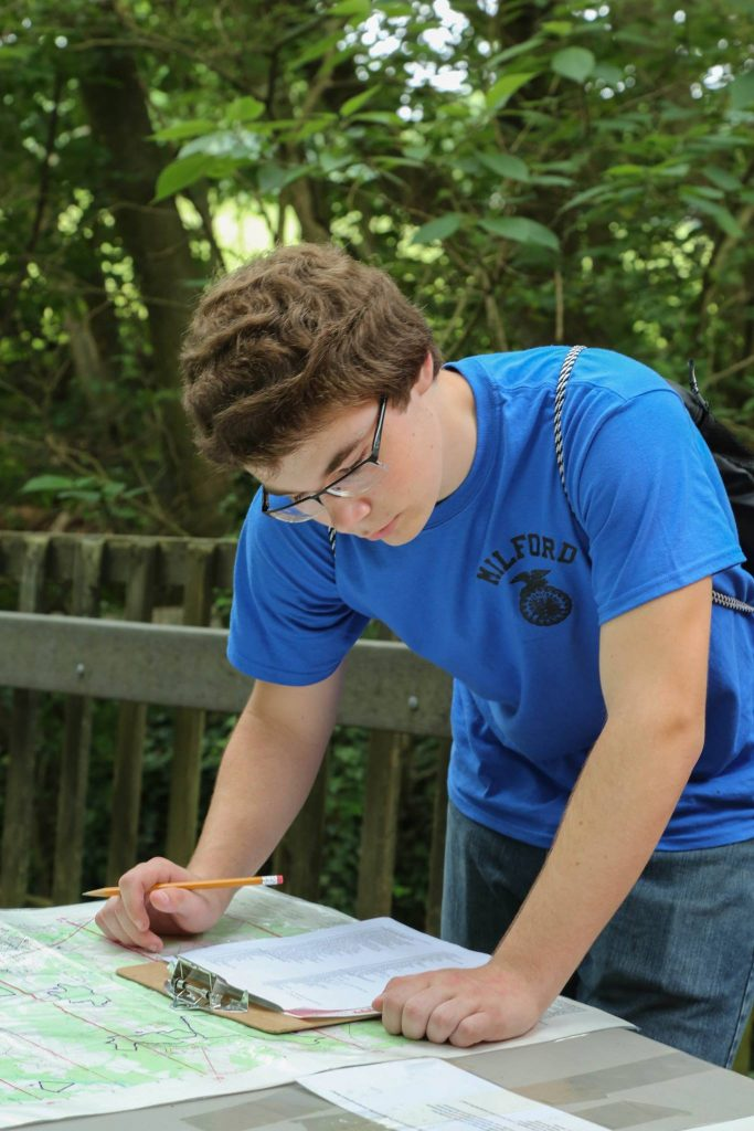 Milford's Cameron Maule reads a topographic map as part of the forestry challenge