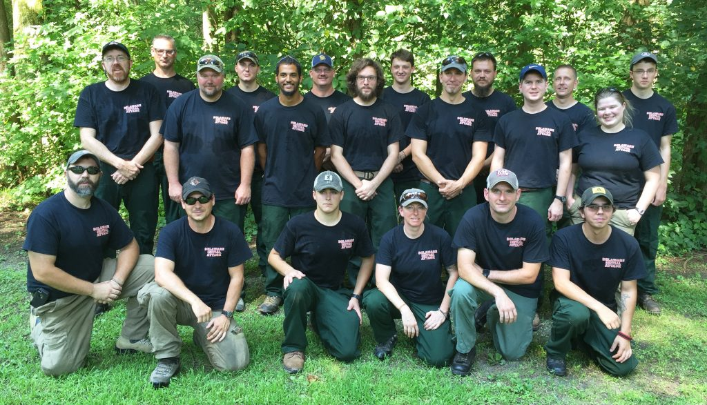 Delaware wildfire crew at Blackbird State Forest: Front Row: (from left) Todd W. Shaffer of Smithsburg, MD; Samual L. Topper of Federalsburg, MD; Christopher S. Riale of New Castle; Monica Testa of Newark; Adam N. Keever of Newark; Alexander J. Jenks of Rehoboth Beach. Back Row: (from left) William T. Seybold of Dover; Charles D. Collins of Newark; Todd D. Gsell of Townsend; Nathaniel J. Sommers of Smyrna; Daryl D. Trotman of Milford; Scott A. Veasey of Millsboro; Zachary R. Brown of Harbeson; Spencer F. Valenti of Dover; Bartholomew D. Wilson of Dover; Jeffrey A. Wilson of Clayton; Daniel A. Mihok of Camden; Michael L. Krumrine of Magnolia; Laura K. Yowell of Trappe, MD; and, Christopher R. Valenti of Dover.