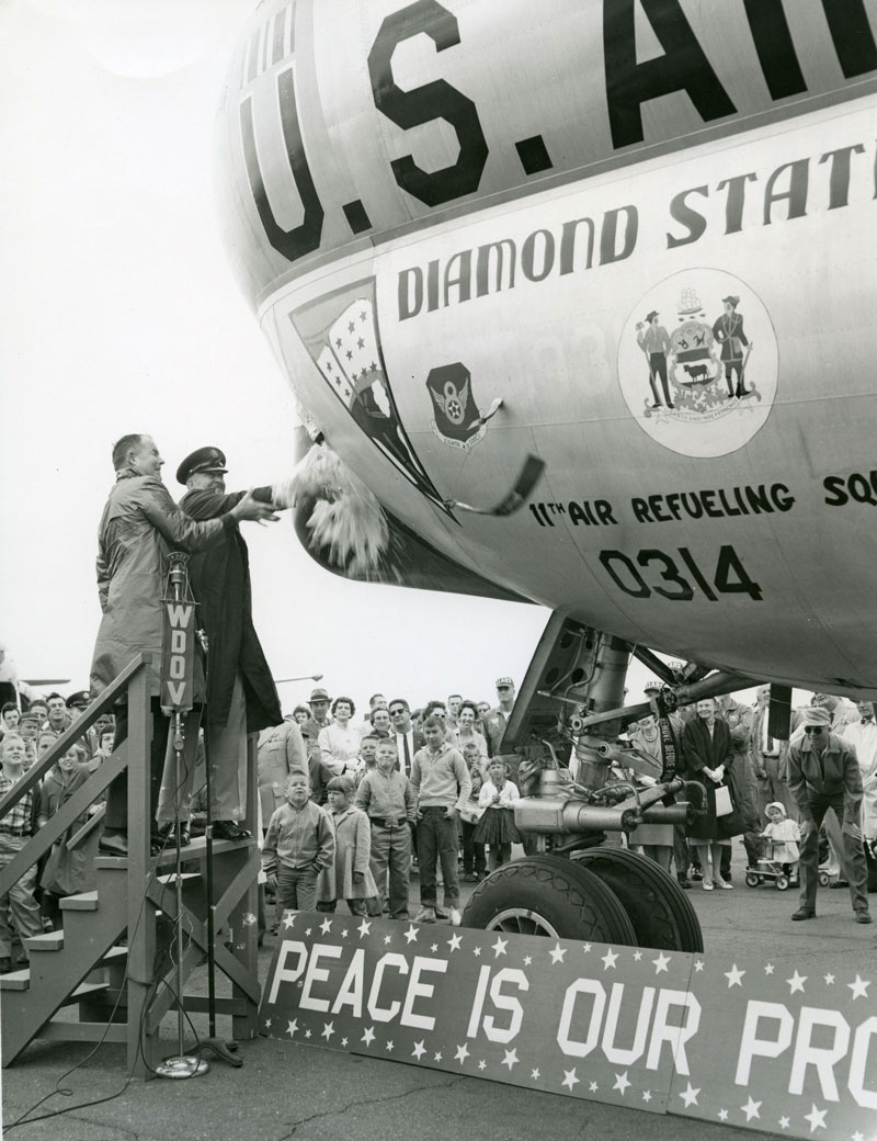 "Governor Carvel (on the left) christening ""Diamond State Tanker"" with Staff Sgt. Goodin, Armed Forces Day, Dover Air Force Base, May 25, 1961"