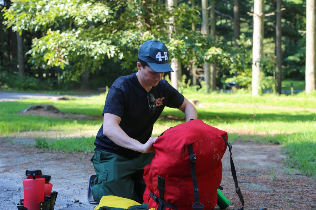 Allen Austin Gardner-Bowler of Milford, a rookie making his first trip with a Delaware wildfire crew, packs his gear.