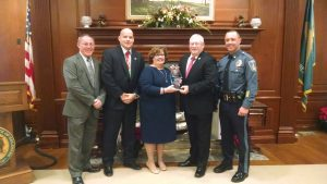 From the left: Gary Melvin, Christian Kervick, Patricia Dailey Lewis, Chief John Horsman, lt. Britt Davis
