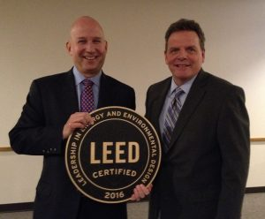 Governor Jack Markell and DNREC Secretary David Small display the Richardson & Robbins Building's LEED certification plaque.