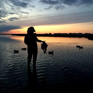 "First place 2016/17 Hunting Photo Contest winner, ""Couples Retreat,"" taken by Bo Wilkinson of Dagsboro, featuring his friend Morgan Anton after a successful waterfowl hunt on the Indian River."