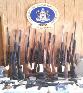 Firearms and ammunition cache from execution of NRP search warrant against Randy T. Combs