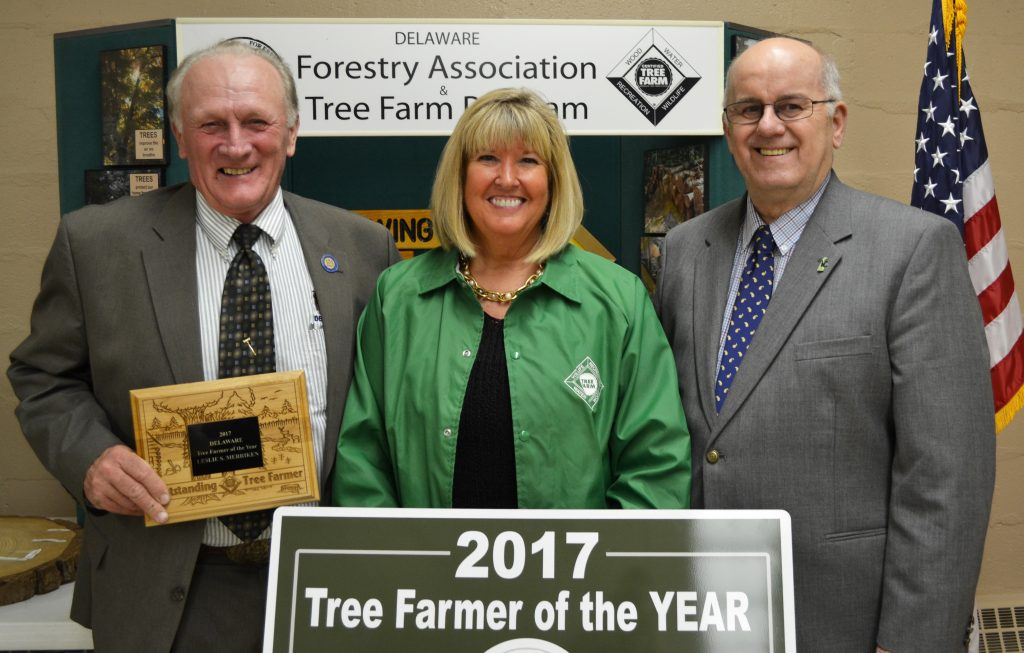 "Rep. David L. Wilson (R-35) and Rep. William R. ""Bobby"" Outten were on hand to honor Leslie Merriken as Delaware's 2017 ""Tree Farmer of the Year."""