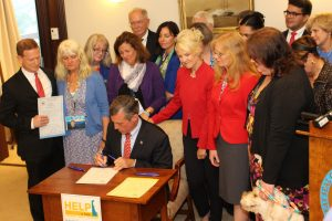 Gov. Carney signs legislation.