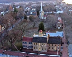 Aerial view of the New Castle Green. In the foreground is the New Castle Court House Museum, followed counterclockwise by the Arsenal, Immanuel Episcopal Church and the Academy. Photo by Bruce Burk