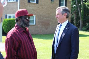 Governor Carney speaks with U.S. Marine Corps veteran Gregory Larry of Wilmington, who moved into an apartment at the Summit at Middleboro Crest in February after experiencing homelessness, working through the VA and Connections CSP.