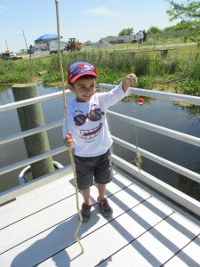 'Take a Kid Fishing!' teaches conservation - and the excitement of catching a fish. DNREC photo.