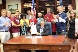 Governor Carney signs legislation removing barrier to absentee voting for Delaware voters