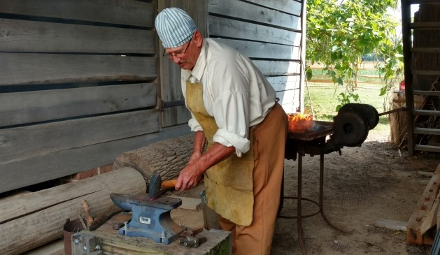 "Blacksmith Richard Shehorn working at the John Dickinson Plantation. Blacksmithing will be featured in the ""18th Century Trades Day"" program on Oct. 14, 2017."