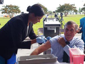 Governor John Carney getting his annual flu shot from DHSS Secretary Dr. Kara Odom Walker