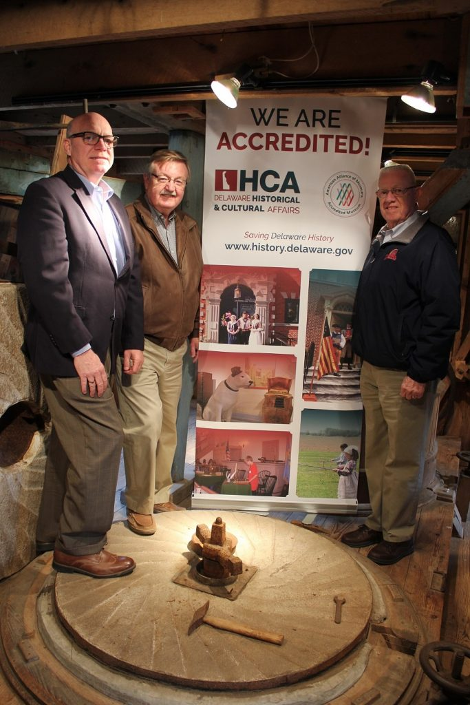 State Sen. Gary Simpson and state Rep. Harvey Kenton visit Abbott's Mill in Milford in celebration of the Division of Historical and Cultural Affairs' accreditation by the American Alliance of Museums. From left: division director Tim Slavin, Simpson and Kenton