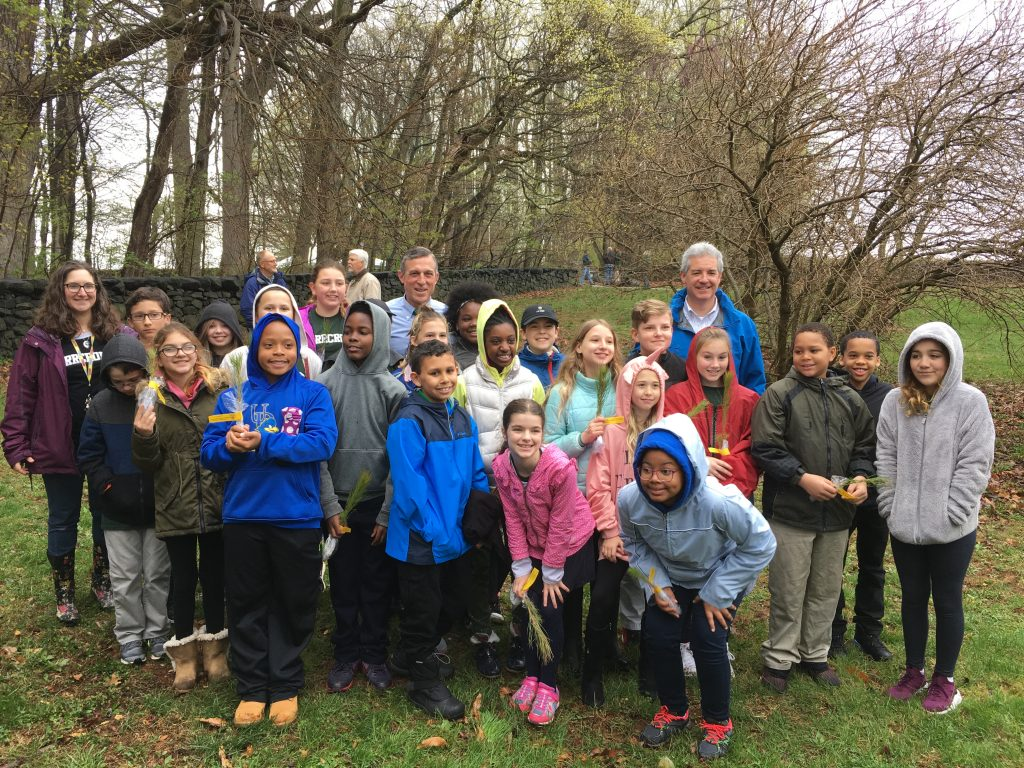 Students from Maple Lane Elementary School join Governor John Carney (left) and DNREC Secretary Shawn M. Garvin at the Tulip Tree Woods Nature Preserve in Brandywine Creek State Park, dedicated today as part of the Old Growth Forest Network, a national organization working for forest preservation.