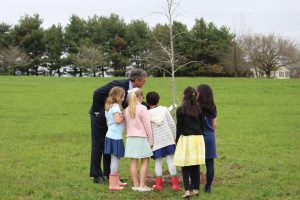 Governor Carney looks at a tree planted by students at North Star Elementary
