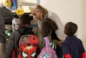 First Lady Tracey Quillen Carney talks to student at Richardson Park Elementary School in Wilmington during School Breakfast Week in March.