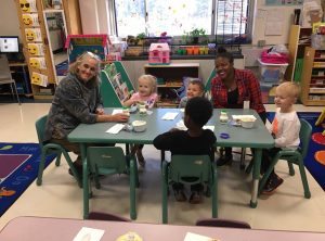 Picture of First Lady Tracey Quillen Carney and young students with an educator