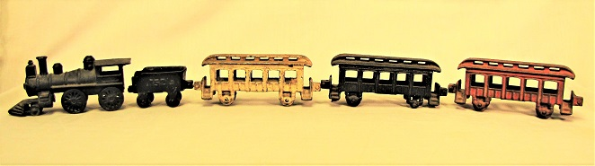 Cast iron passenger train including engine, tender and three passenger cars. Made by Vindex Toy Company, Belvedere, Ill., circa 1905.